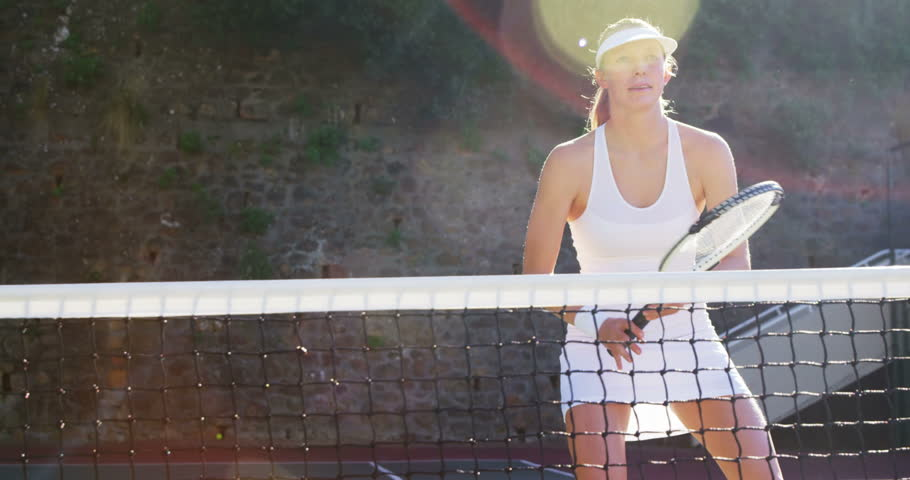Active sportswoman playing tennis in tennis court