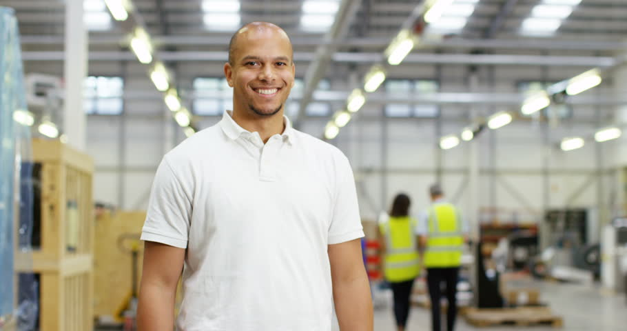 4k, Portrait of a cheerful and friendly African American male warehouse manager. Slow motion.