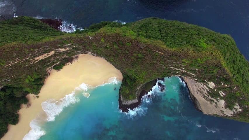 Aerial overhead view of Kelingking Beach in Nusa Penida, Bali, Indonesia.