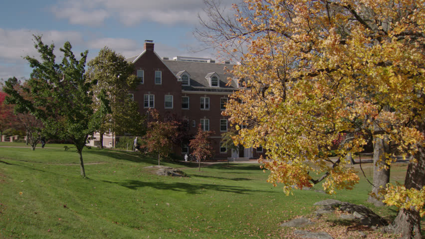 day across eastern college campus 4 story brick school building dorm small entry columns, fancy dormers, few students, very , fall autumn, (Oct 2012)