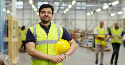 4k, Portrait of a cheerful and friendly male warehouse manager. Slow motion.