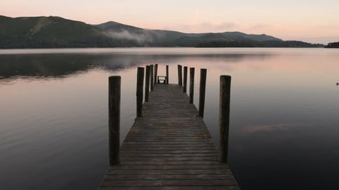 Lake Derwent water and Ashness jetty in English lake district at sunrise.