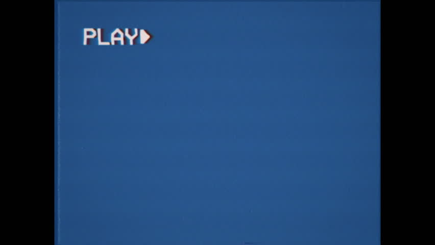 An old damaged VHS tape playing, blue screen with PLAY text. A vintage background for videos, a retro element.