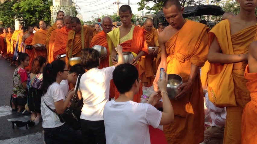 BANGKOK - MARCH 17: Monks are participating in a Mass Alms Giving of 12,600 monks for the Makha Bucha celebrations on March 17, 2012 in Bangkok, Thailand.