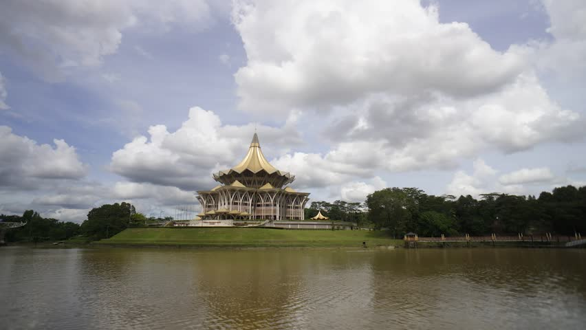 Kuching Sarawak - Circa Dec 2016 : Time lapse of cloudscape with Sarawak River and Sarawak State Assembly building at foreground during cloudy day. Sarawak is the largest state in Malaysia.