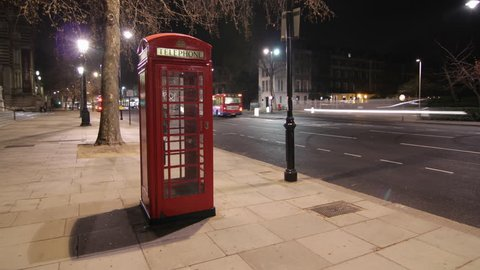 Time lapse - Telephone box at night in London, UK