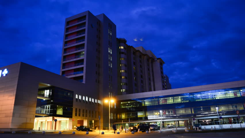 Generic Health Care Modern Hospital Exterior Building at night. 4K Time Lapse