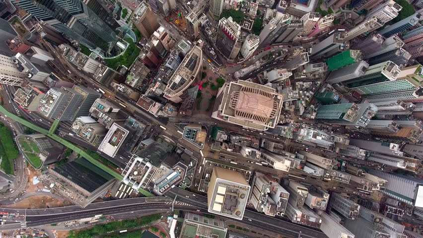 Top view aerial shooting of high technology developed district of Hong Kong city with high-rise skyscraper buildings and active traffic on road.Video can be used for advertising or filmmaking industry | Shutterstock HD Video #22050649