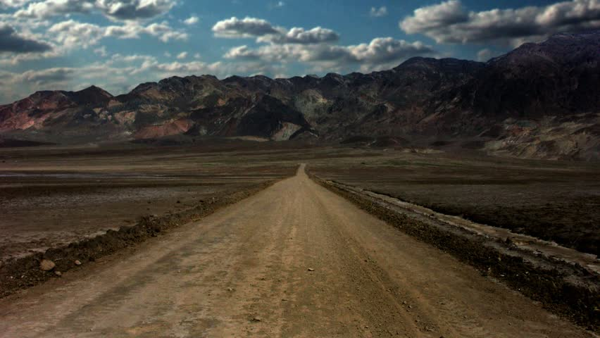 Timelapse of dirt road with mountain landscape, Death Valley, California.