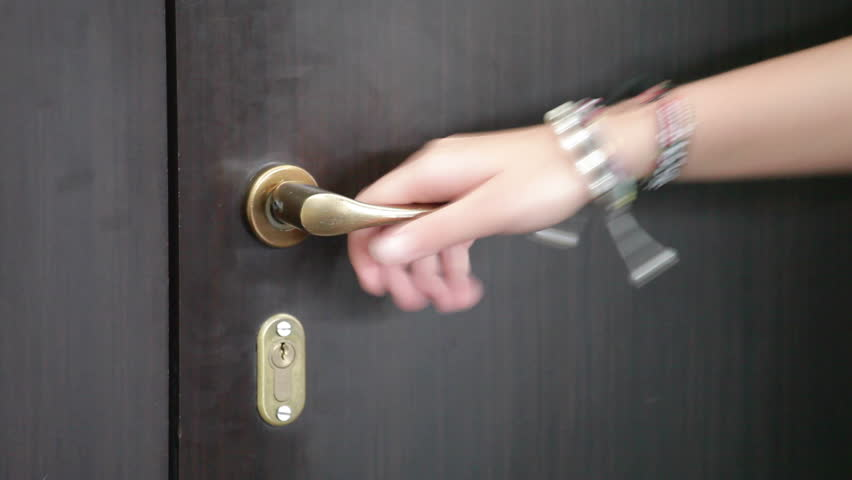 Women hand open door knob or opening the door