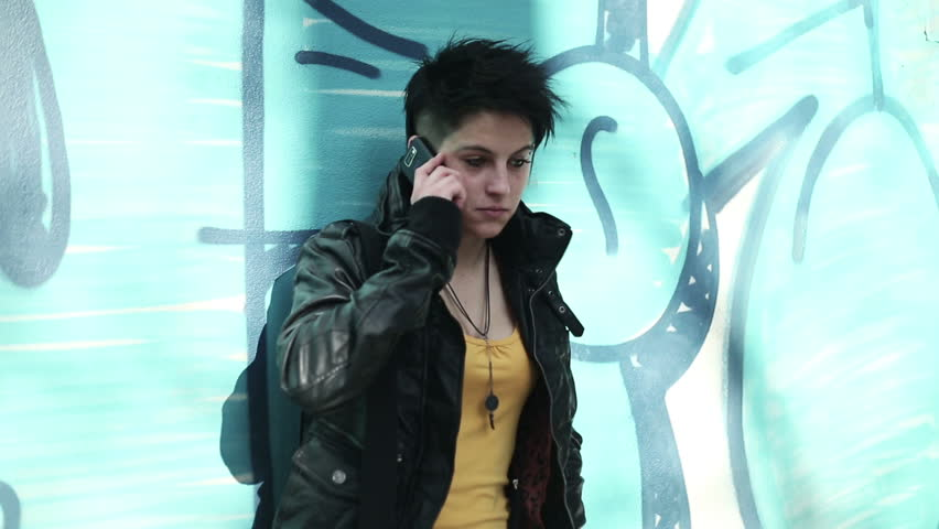 Young punk girl talking on cellphone by the wall   Shutterstock HD Video #2207374