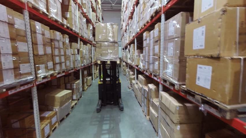 Aerial Footage Forklift Trucks Lift Loads In The Rack Inside warehouse | Shutterstock HD Video #22080415