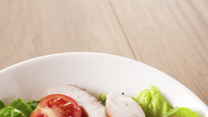 caesar salad closeup camera backwards fly follow falling croutons, 180fps prores footage #22086058