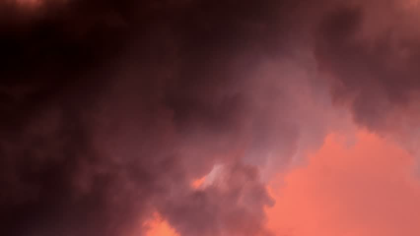 Timelapse of swirling dark red storm clouds.
