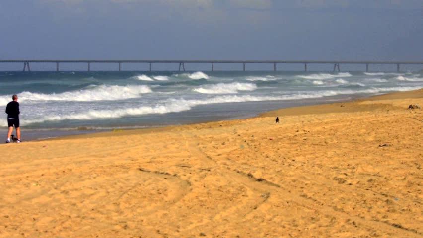 Jogger, Stormy waves, Mediterranean Sea, South of Israel, filmed 50p