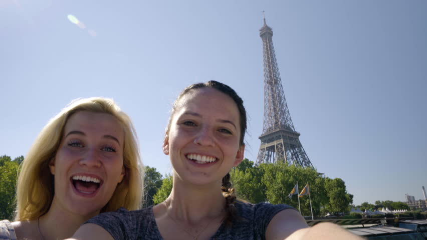 Happy Young Women Pose For Fun Selfies On A Tour Boat Floating Down The River Seine In Paris, Eiffel Tower Prominent In Background #22180054