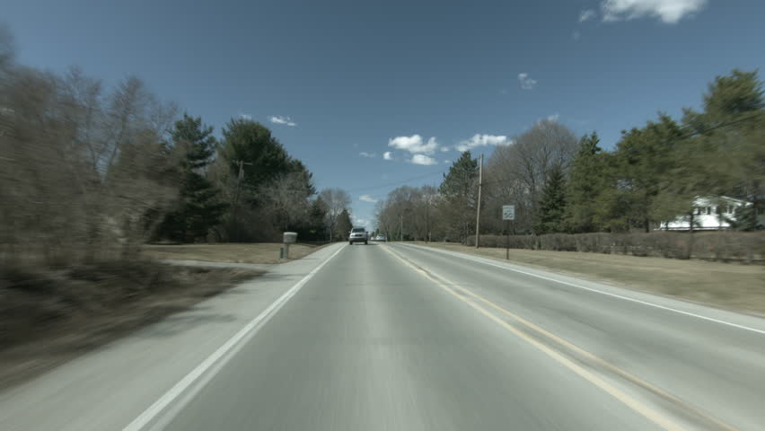 ANN ARBOR, MI - CIRCA 2015: Driving plate: back view. Country road on a bright spring day.  Mid West USA.  24mm lens, part of matched set D. Composite of complete set: https://vimeo.com/195342277