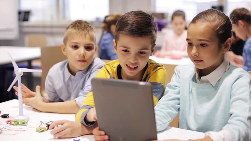 Education, science, technology, children and people concept - group of smiling kids or students with tablet pc computer programming electric windmill toy at robotics school lesson | Shutterstock HD Video #22194394