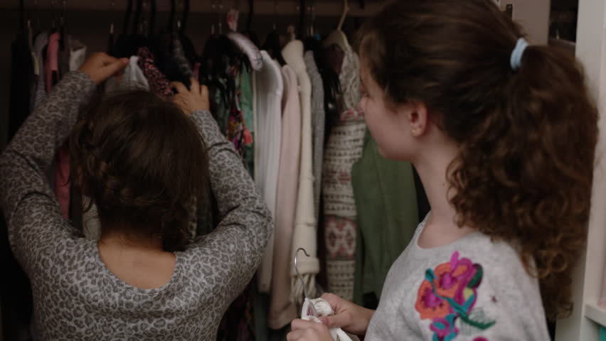 Sisters sharing clothes | Shutterstock HD Video #22196374