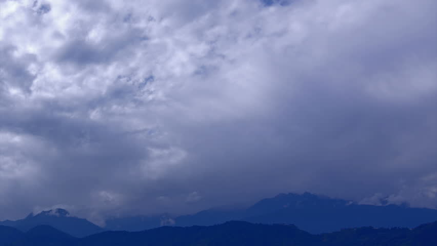 Beautiful time lapse stock footage of clouds passing over Himalayan mountains, Sikkim, India. Day ends in evening video with HD, 1920 x 1020 quality, nature scene.