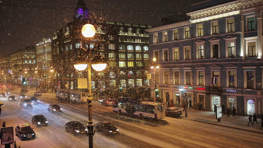SAINT PETERSBURG, RUSSIA - DECEMBER 12, 2016: people and cars moving along Nevsky Prospect in Saint Petersburg at night in heavy snow in winter.  View over the famous historic bookshop. | Shutterstock HD Video #22252246
