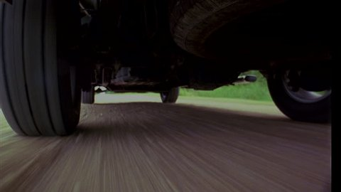 day MPOV low angle Underside pick up truck Gravel road Stopped, starts driving away fast (Jan 2005)