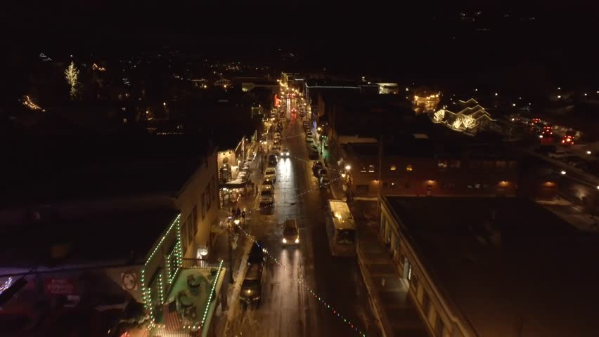 An amazing aerial view of Park City at night in the winter with Christmas lights