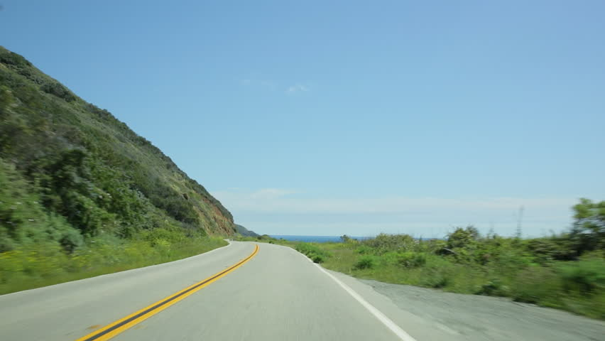 Vehicle point-of-view driving south on California Highway 1 (aka Cabrillo Highway or Pacific Coast Highway) in the Big Sur area of Central California.