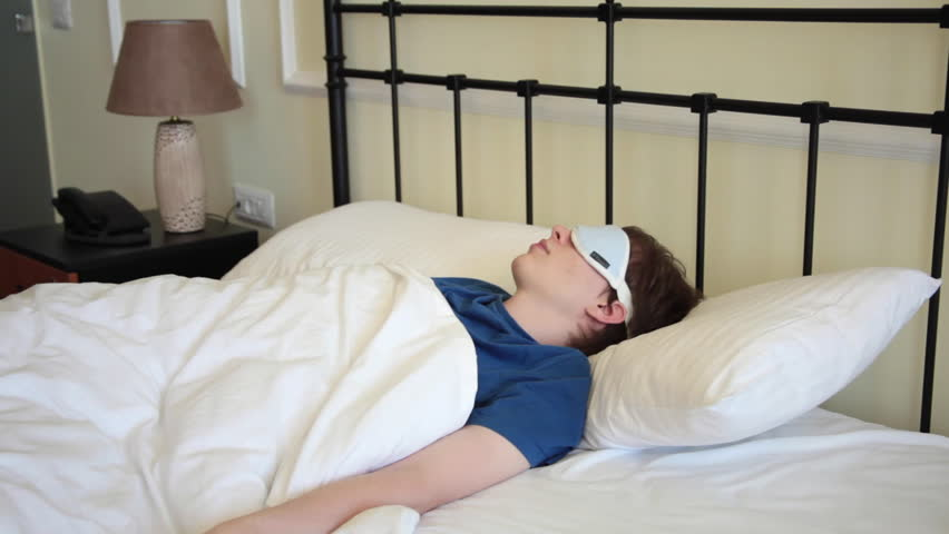 Young Man With Sleeping Mask Lying In Bed The Morning Hd Stock Footage Clip