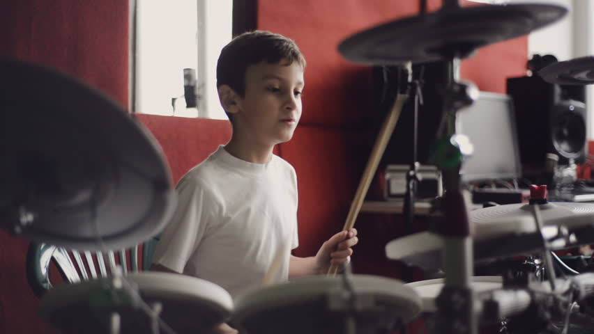 little boy playing electronic drums