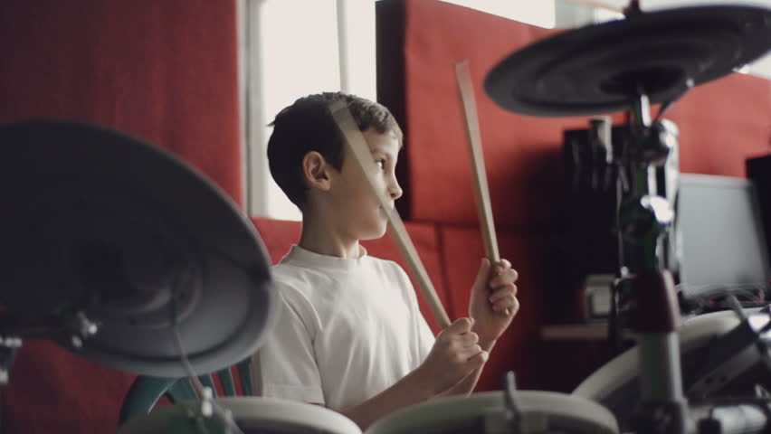 little boy playing electronic drums slow motion
