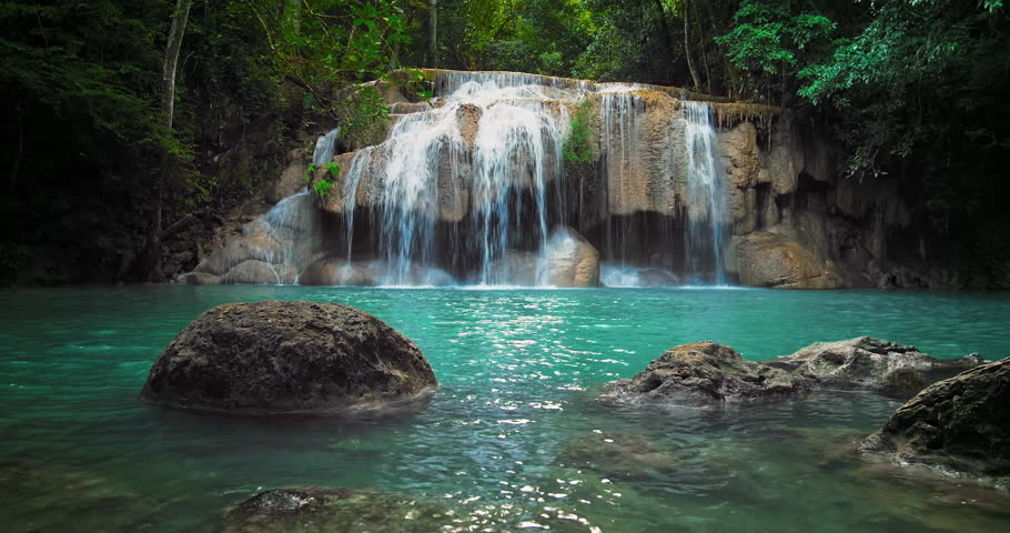 Pristine waterfall with pure clean water pond in tropical forest 4K nature video