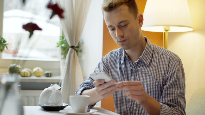 Man sitting by the table and browsing internet on tablet, steady cam shot  | Shutterstock HD Video #22414864