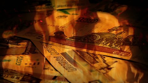 Russian Ruble Banknotes Rotating In Fire