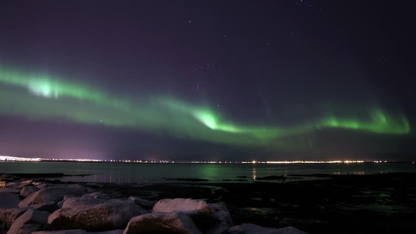 Active Northern Lights over Reykjavik, Iceland