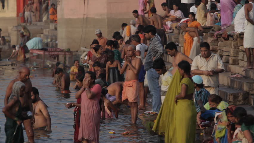 CIRCA 2010: WS Large group of people bathing in Ganges river / Varanasi, India