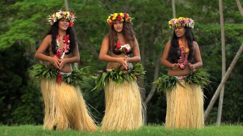 Young female group of Tahitian hula dancers performing outdoor barefoot in traditional costume Tahiti French Polynesia South Pacific