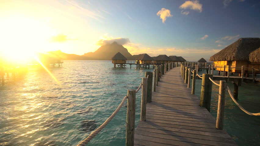 Bora Bora Mt Otemanu in French Polynesia a view of an Overwater Bungalow at sunset luxury tropical hotel resort in the South Pacific | Shutterstock HD Video #22490902