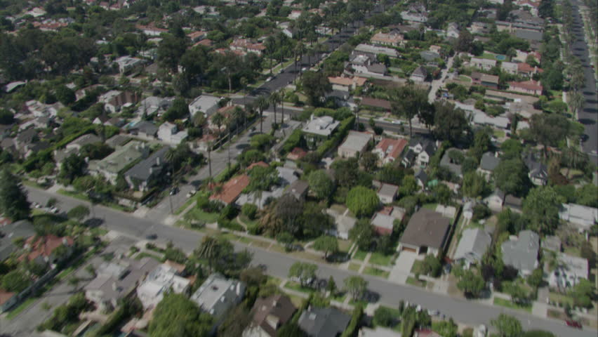 aerial flying shot over suburban Santa Monica, revealing beach and entire coastline circa