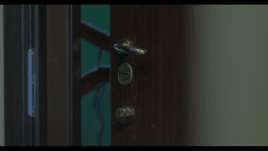 Interior static handheld laboratory s heavy metal security door closing the door can be seen in large door lock hd stock footage clip aloadofball Choice Image