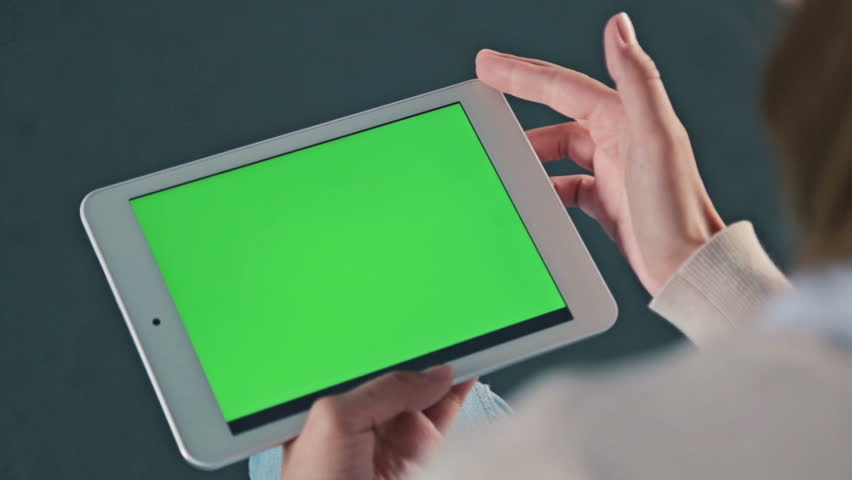 Woman looking at tablet with green screen. Close up shot of woman's hands with pad | Shutterstock HD Video #22540144