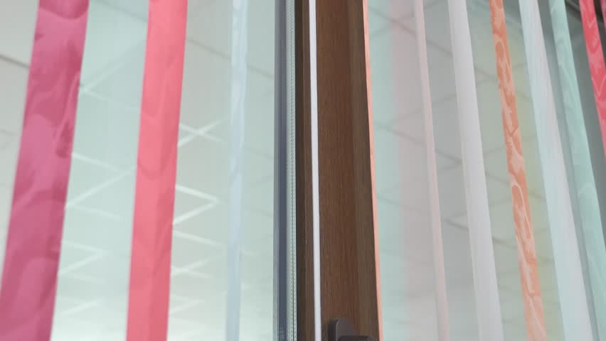 vertical color window blinds in motion. #22560070