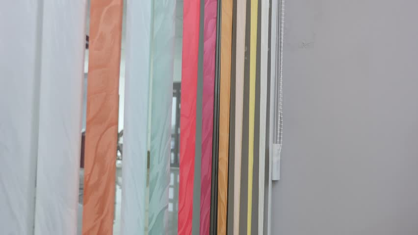 vertical color window blinds in motion. #22560103