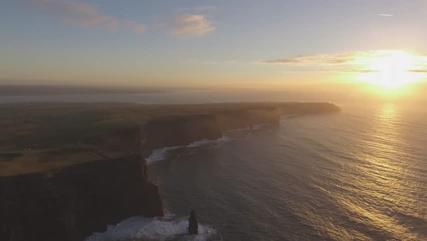 Aerial Ireland countryside tourist attraction in County Clare. The Cliffs of Moher and castle Ireland. Epic Irish Landscape  along the wild atlantic way. Beautiful scenic irish nature . Flat video
