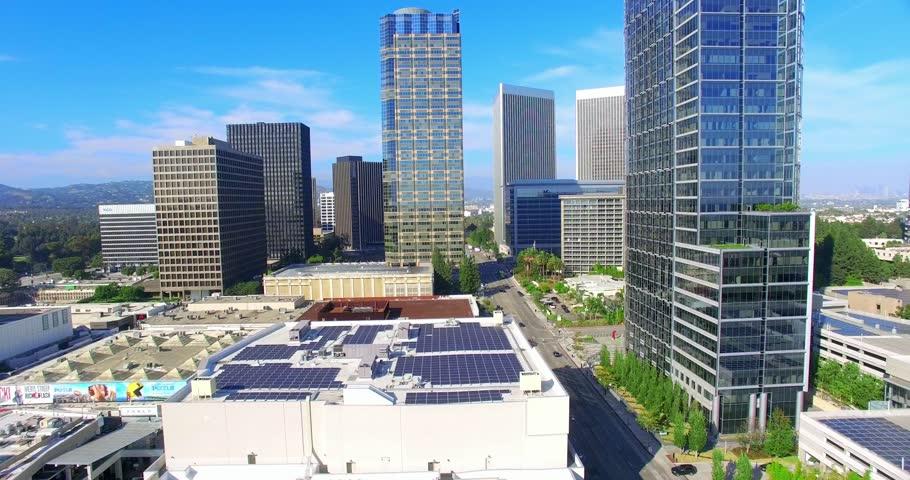 Aerial view of Century City and Fox Movie Studios using solar panels, Los Angeles, California, 4K