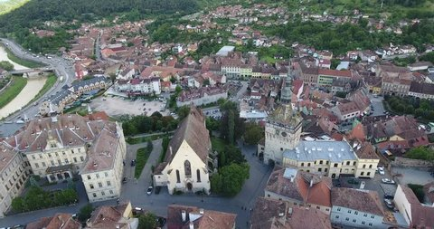 Sighisoara medieval city in the heart of Transylvania, Romania, birthplace of Count Dracula. Aerial footage from a drone