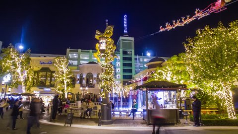 GROVE SHOPPING CENTER, LOS ANGELES - CIRCA NOVEMBER 2016: 4K Hyperlapse of the shopping mall decorated with holiday illuminations during Christmas.