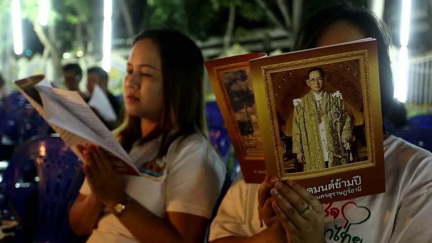 SURAT THANI, THAILAND- DEC 31 : Unidentified people in cross over night to 2017 Buddhism prayer service at Surat Thani City Pillar Shrine on December 31, 2016 in Surat Thani, Thailand.  | Shutterstock HD Video #22715854