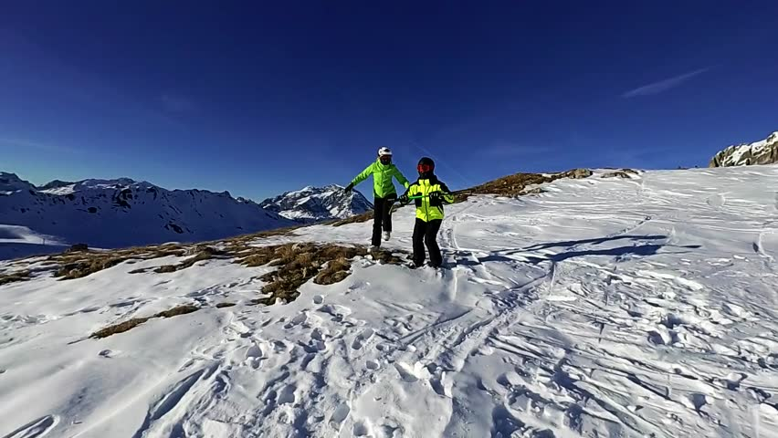 Happy couple is dancing on the mountain on sunny day, Tignes, France | Shutterstock HD Video #22736284