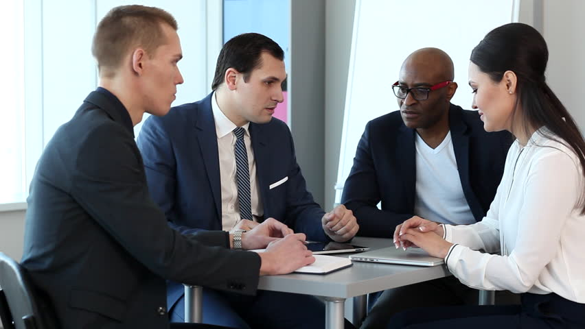 Two experienced businessman preparing young managers for a meeting with clients. All issues have been resolved/Tips Experienced Businessmen to the Young Managers Before Meeting With Customers | Shutterstock HD Video #22758301